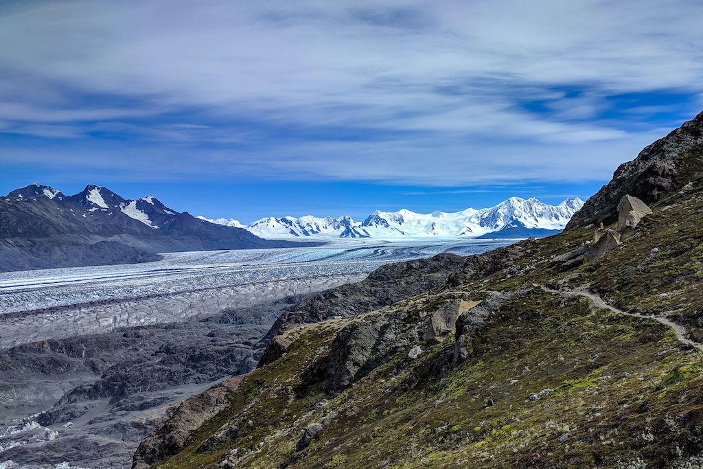 A trail leading towards the South Patagonian Ice Fields with snow-capped mountains in the backdrop