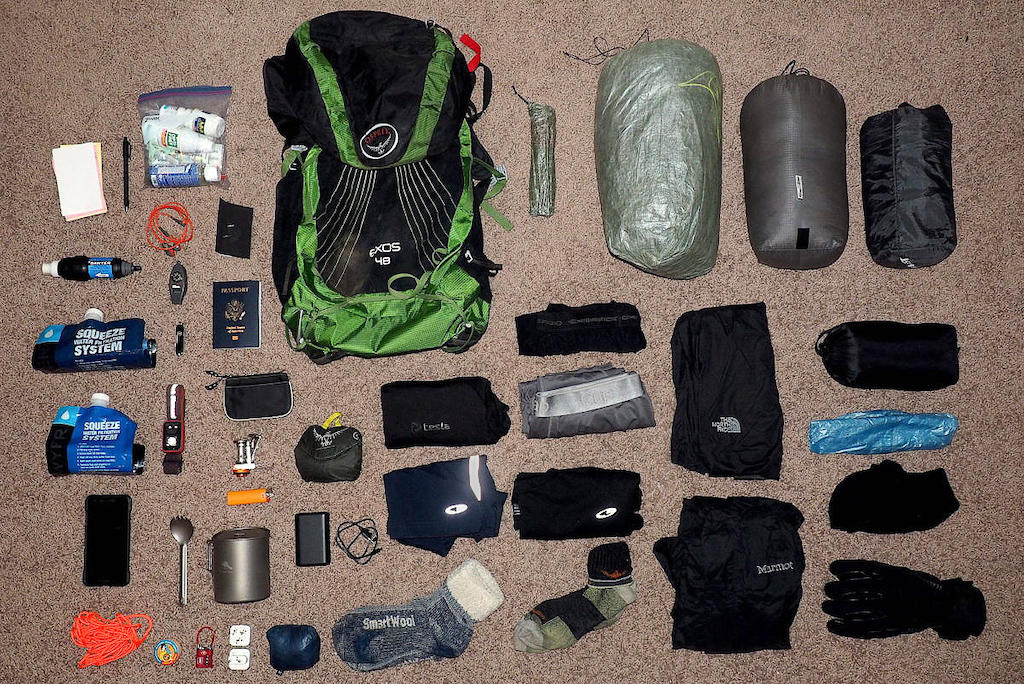 Above view of my backpacking gear laid out across a carpet