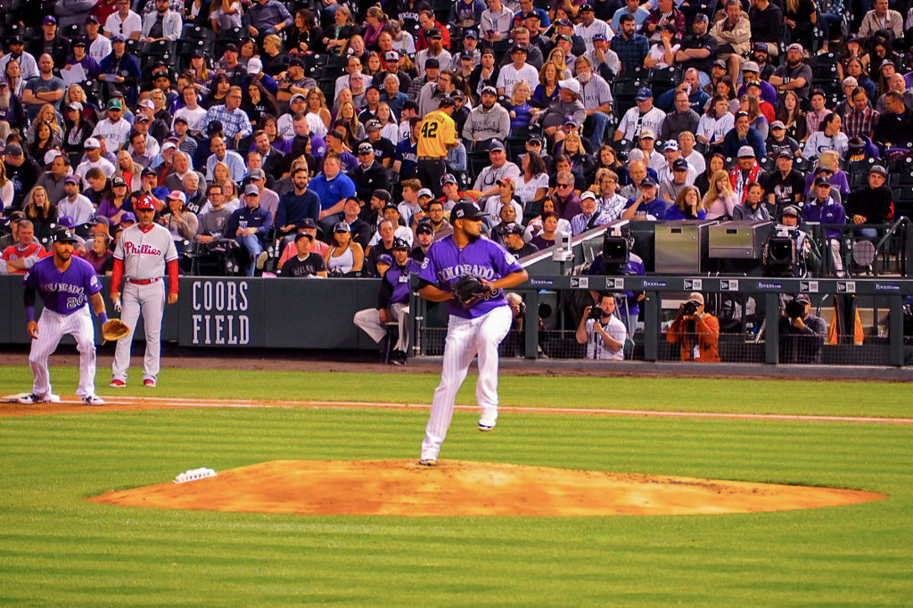 German Marquez rearing back to throw a pitch at Coors Field in Denver, Colorado