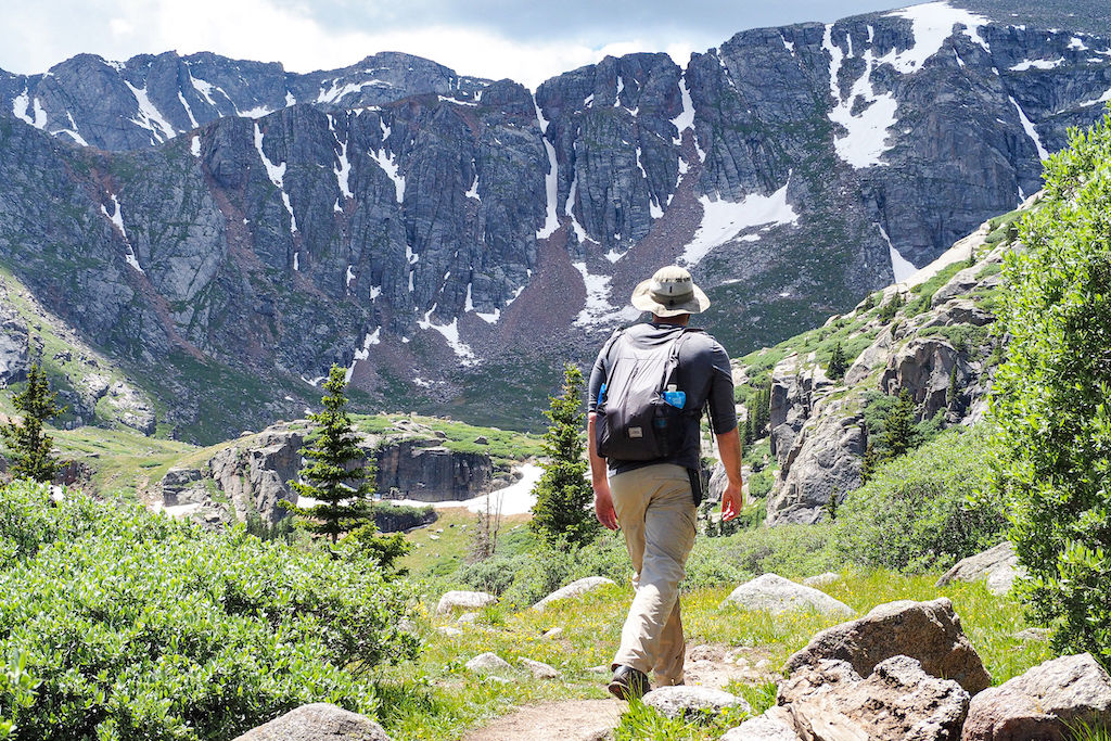 A man hiking towards a mountain range during a 10,000 step challenge