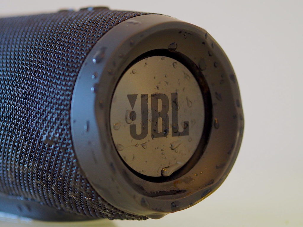 Closeup of the JBL Charge 3 subwoofer dripping with water