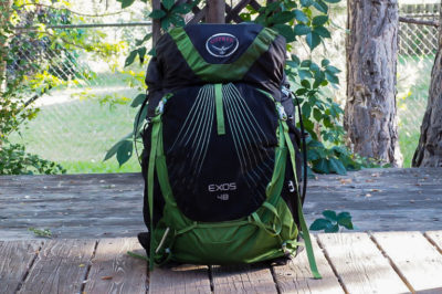 Osprey Exos 48 backpack propped up on a back porch