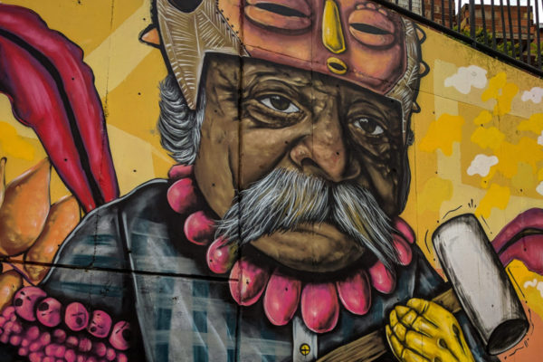 Edited photo of street art of a man holding a sledge hammer in Medellin, Colombias