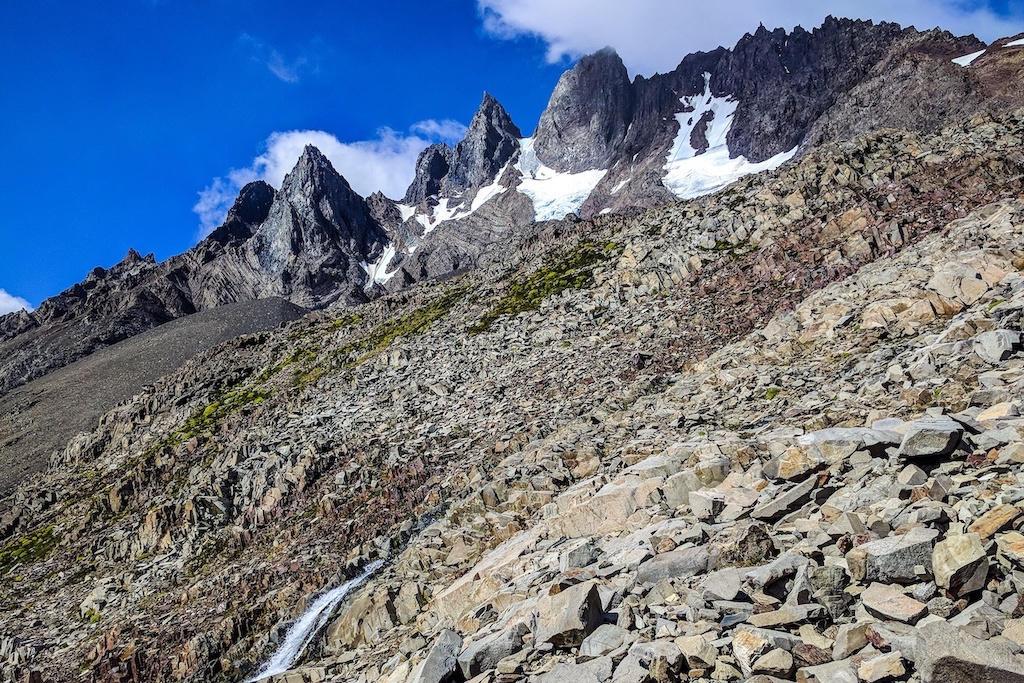 A waterfall and granite peaks on John Gardner Pass on the 'O' Circuit trek in Torres del Paine