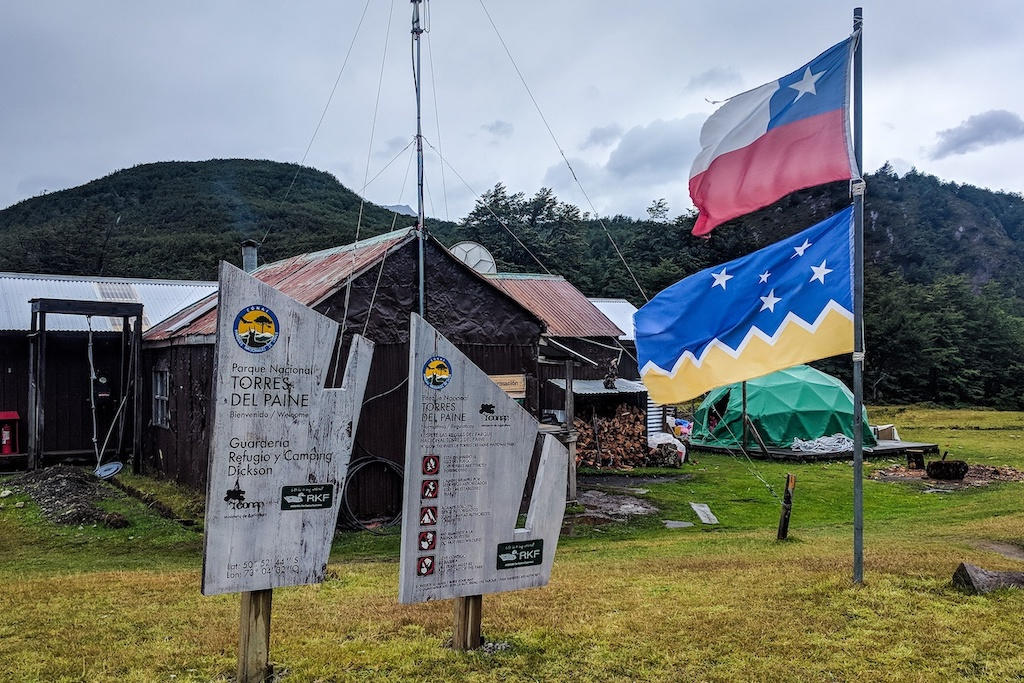 Chile flag whipping in the wind at Dickson campgrounds on Patagonia's 'O' Circuit trek