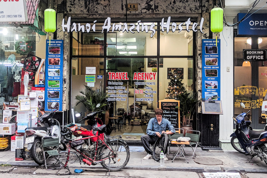 A front view of the glass storefront of Hanoi Amazing Hostel