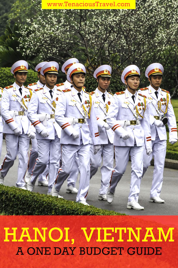 Soliders dressed in white marching down a street