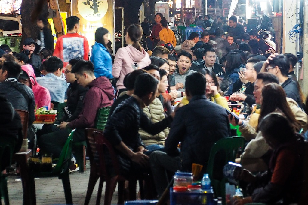 Hanoi diners fill in the sidewalk during a one day celebration in the city