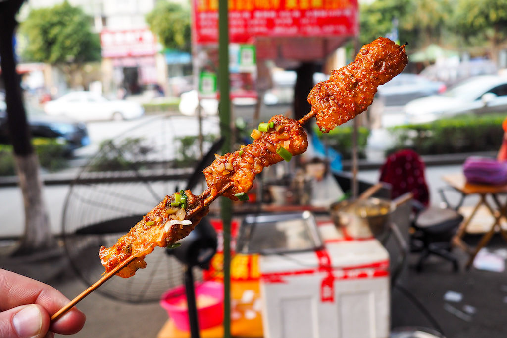 A grilled pork belly skewer on the streets of Chengdu for my 32 food blog challenge