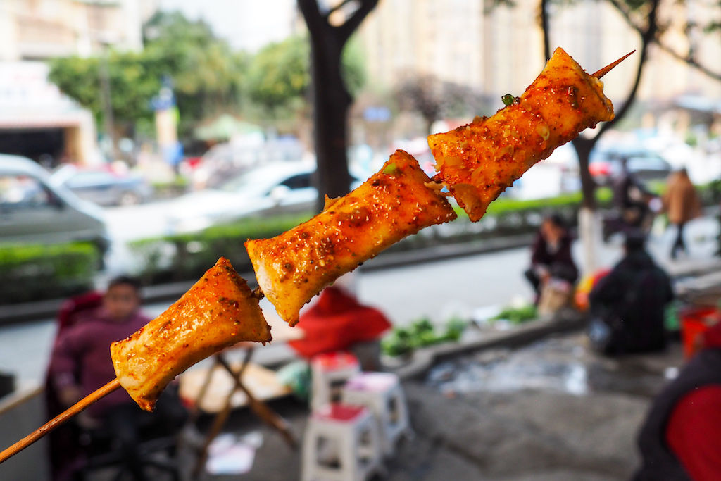 A grilled skewer of generously season shrimp dumplings