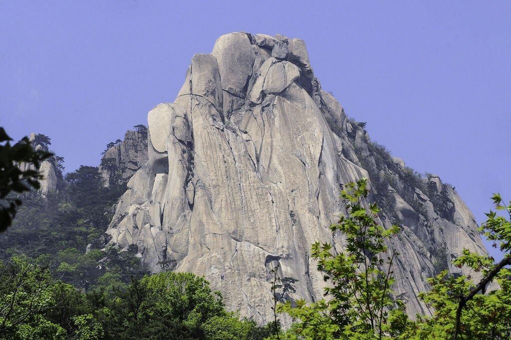 A prominent mountain peak near Seoul, South Korea stands tall against a blue sky