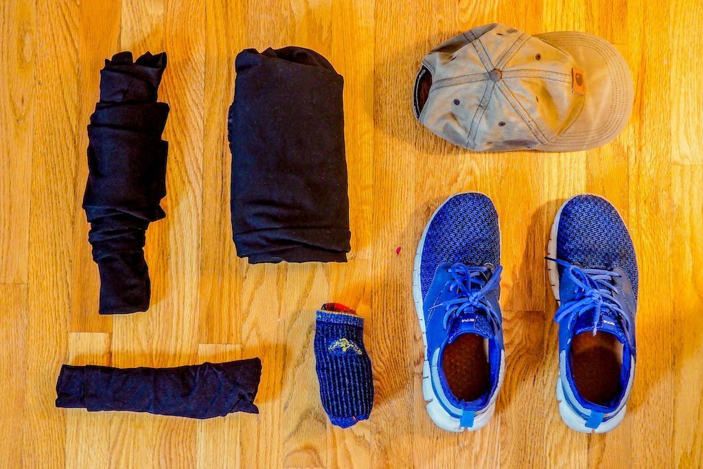 Clothing on a hardwood floor for carry-on only travel