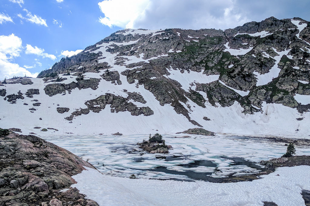 Booth Lake in Vail, Colorado frozen over with a layer of snow on top