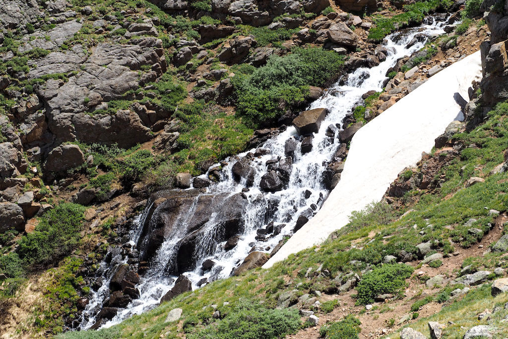 Waterfall flowing over rocks in the Arapaho National Forest in Colorado