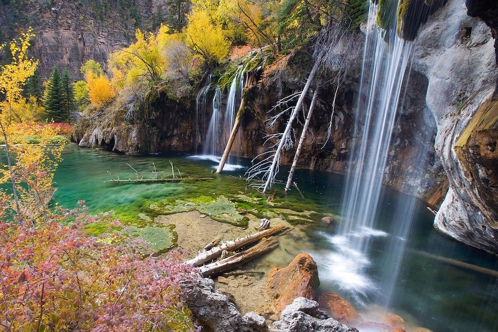 Thin waterfalls feeding into a crystal clear lake