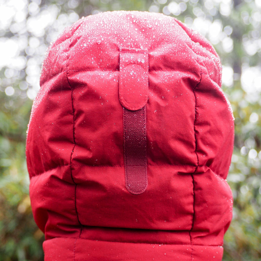 Backview of velcro on the hood of a Montbell brand red down parka